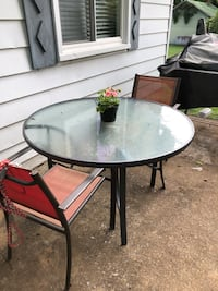 round black metal framed glass top patio table Rockingham, 22802