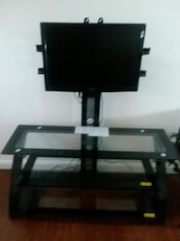 black flat screen TV with black TV stand
