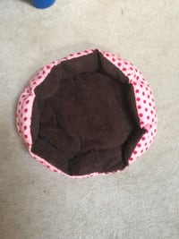 Pink and brown polka dotted pet bed