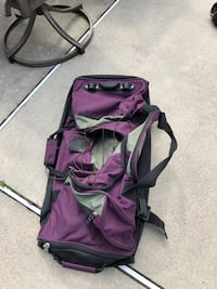 Rolling duffle bag suitcase