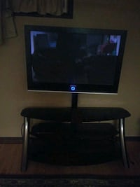 Samsung 50 inch TV With black and chrome stand. The stand has 3 levels