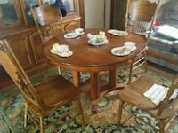 round brown wooden table with four chairs dining set Kokomo, 46902
