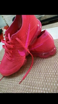 pair of red Nike running shoes Houston, 77042