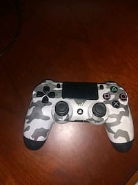 white and black camouflage Sony PS4 controller Laurel, 20708