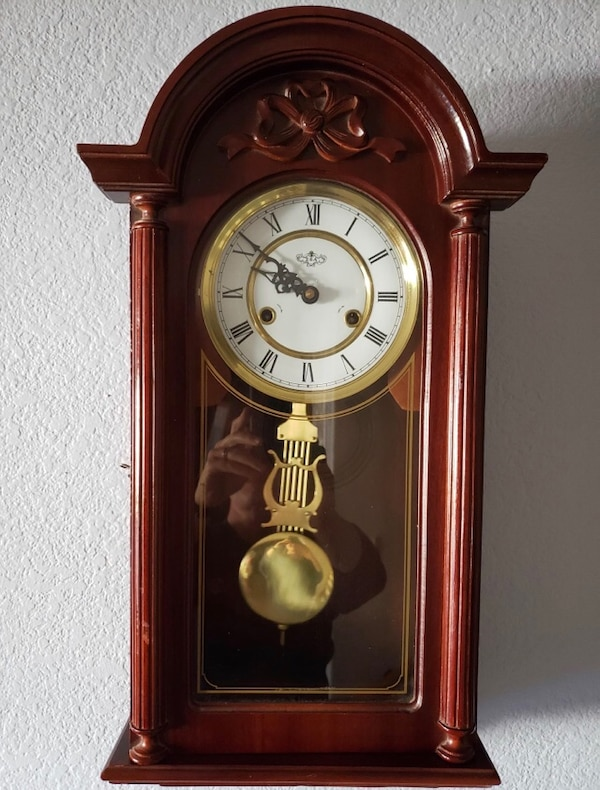 Ornate wall clock  Works well and is in great shape!