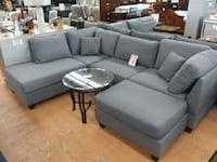 gray suede sectional couch wit throw pillows and ottoman Lakeland, 33815