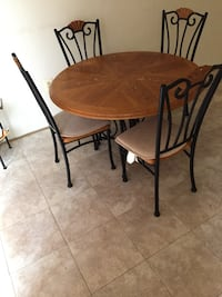 round brown wooden table with four chairs dining set Severn