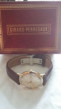 GIRARD PERREGAUX SOLID GOLD WATCH Aurora