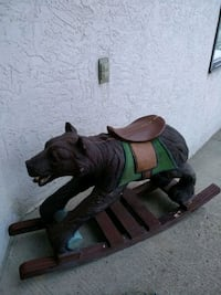 Solid wood carved rocking bear
