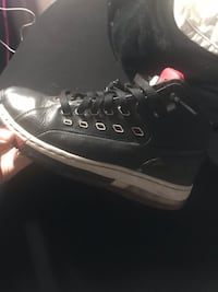 pair of black leather low top sneakers Middlesex Centre, N6P 1P2
