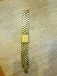 square gold-colored analog watch