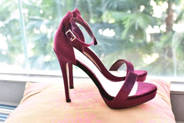pair of red suede pointed-toe pumps