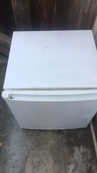 white compact refrigerator