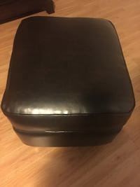 black leather padded chair with brown wooden base Brampton, L6R 1J2