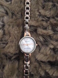Nine west watch, the end to clip it on is missing.