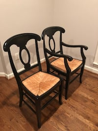 two black metal framed brown padded chairs 26 km