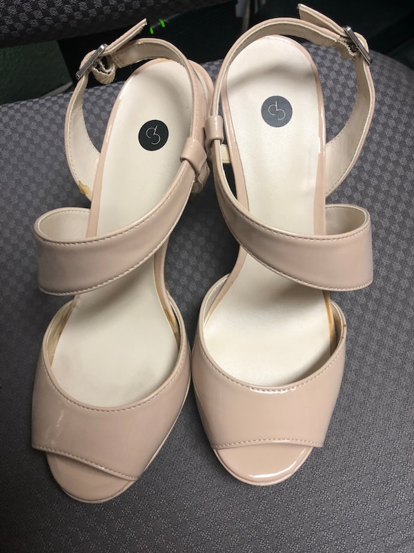 pair of white leather open-toe heeled sandals