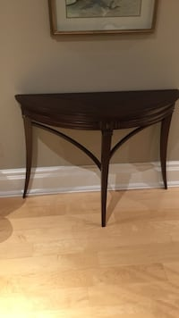 Brown wooden half-circle side table