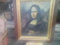 brown wooden framed painting of man Montreal, H8S 3P7