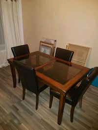 Dining room table with glass top and 4 chairs