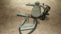 gray and black canister vacuum cleaner