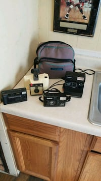 4 cameras 2 Polaroid, 2 roll film with 1 bag  Sumter, 29150