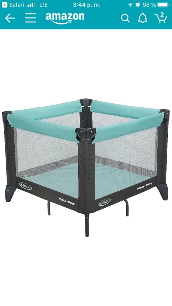 Green and black travel cot