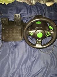 black and green steering wheel game controller