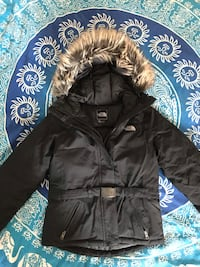 Black zip-up parka jacket