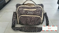 women's brown and white flower print diaper bag