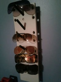 brown and white wooden wall mount rack