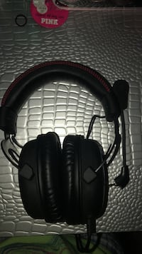 Black and red corded headphones with detachable mic. Universal, used for xbox, ps4, and pc! Chesapeake, 23323