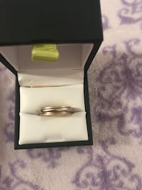 gold-colored and silver-colored ring with box