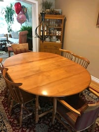 round brown wooden table with four chairs dining set Pitt Meadows, V3Y 2B5