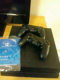 black Sony PS4 console with controllers Newport News, 23604