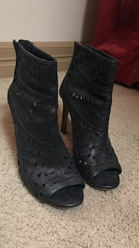 Pair of black leather peep-toe heeled boots