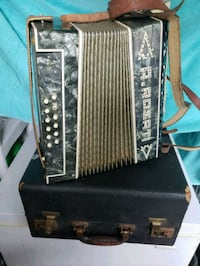 Vintage accordian with case Gloucester City