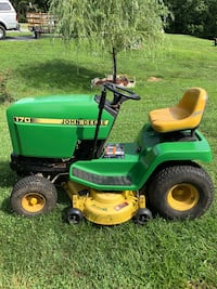 green and yellow John Deere ride on lawn mower Falling Waters, 25419