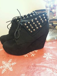 pair of black suede wedge booties 464 km