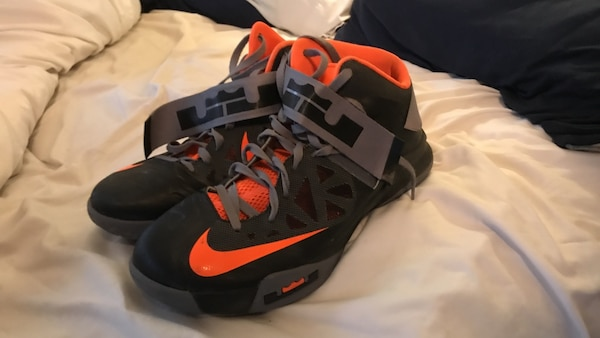 443cc2218d51 Used pair of black-and-orange Nike Lebron James basketball shoes for ...