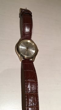 round silver analog watch with brown leather strap Penngrove, 94951