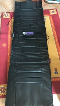 Black electric body massager pad