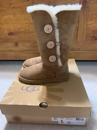 pair of brown UGG boots on box Winchester, 22602