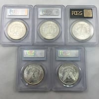 six round silver-colored coins PITTSBURGH