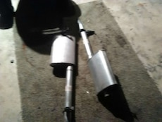 two stainless steel car mufflers