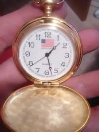 round gold-colored analog pocket watch Omaha, 68164
