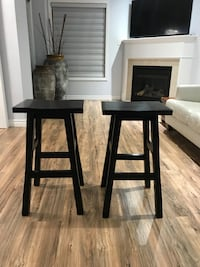 two black wooden chairs