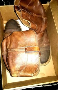 pair of brown leather cowboy boots Oklahoma City, 73129