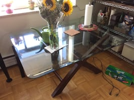 Dark brown wooden framed glass top table