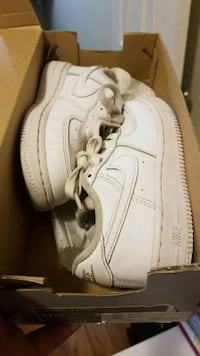 pair of white Nike Air Force 1 low-top shoes with box
